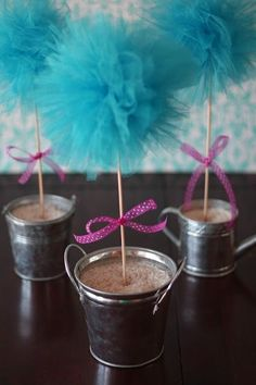 Tulle Pom Pom Topiary DIY.   Could use RED / WHITE / BLUE tulle for 4th of July decor!  Would resemble a firework too on top.