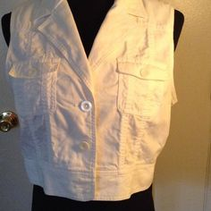 Cute White Vest Cute white vest perfect for summertime! 3 buttons down front or leave open. Great over your favorite dress or top. Ideology Tops