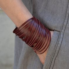 This dark wine red Nida leather bracelet is made from thick footwear leather. Wrap around your wrist twice and close with snap. Wavy and beautiful! This bracelet is good for a 6,25-7 wrist (15,5cm-17,5cm) The leather used in this bracelet is a surplus leather from footwear industry. More leather bracelets: https://www.etsy.com/shop/SalmiakStudio?section_id=13737692&ref=shopsection_leftnav_5 Please read the shop POLICIES before you order. Follow my label on Facebook - www.facebook.com/Sal...
