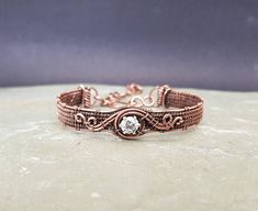 Check out this item in my Etsy shop https://www.etsy.com/uk/listing/583555932/cubic-zirconia-and-copper-bracelet-7th