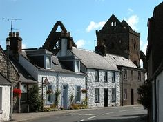 New Abbey Main Street and Sweetheart Abbey, Dumfries and Galloway, Scotland.