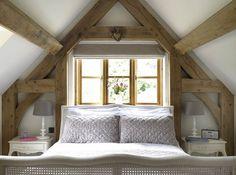attic bedroom w/wooden beams.