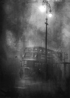 A London bus makes its way along Fleet Street in heavy smog, December 1952.
