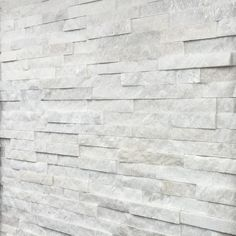 White Quartz Mini Split Face Tiles 600x150x8-15mm - Oyster split face panels offer the same beautifully earthy tones and varied surface texture as the oyster slate floor tiles but with the added benefit of being an easy to install, 'Z' shaped cladding panel.
