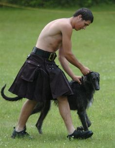 Man in kilt with dog
