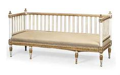 A NORTH EUROPEAN NEO-CLASSICAL CREAM-PAINTED AND PARCEL-GILT SOFA  EARLY 19TH CENTURY  Images