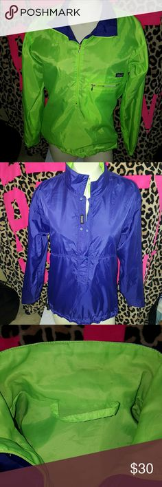 Patagonia reversible jacket **selling as is.....the collar is discolored on the green side. Not noticeable when collar is flipped down. This is a non specified gender size xm, reversible bright green one side bright grape purple on reverse. Winddbreaker material, 3/4 zip on green side and 3/4 snap on purple side. Patagonia Jackets & Coats