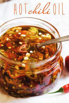Homemade Hot Chili Oil Recipe. Made with good quality extra virgin olive oil and fresh hot chili peppers.
