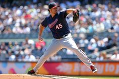 Jun 1, 2014; Bronx, NY, USA; Minnesota Twins starting pitcher Phil Hughes (45) pitches against the New York Yankees during the first inning of a game at Yankee Stadium. Mandatory Credit: Brad Penner-USA TODAY Sports