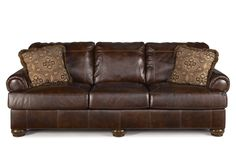 Axiom Leather Sofa from living spaces... $1870 for sofa and love seat set.