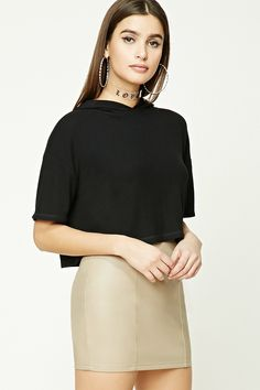 A lightweight ribbed knit crop top featuring hood with a surplice neckline, short dropped sleeves, and a boxy silhouette.