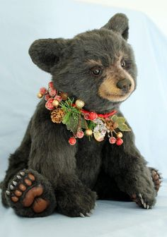 Stuffed Christmas bear toy, with holiday collar.