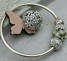 PANDORA Bangle with Wildflower Murano and White Daisy Spacer with Ring to Match.