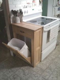 #27. Make a garbage can cabinet and cutting board countertop for your small kitchen! | 29 Sneaky Tips For Small Space Living