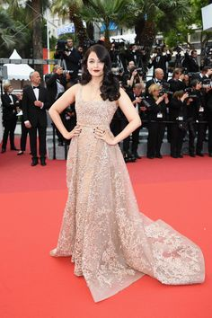Aishwarya Rai attended the same premeire in a lacy champagne number.