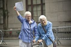 Phyllis Sifel (L) and Connie Kopelov celebrate after being married at the marriage bureau in lower Manhattan July 24, 2011.   REUTERS-Alliso...