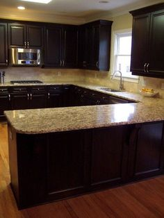 My dream kitchen!! Love dark cabinets and lighter countertops and new appliances - best combo!!