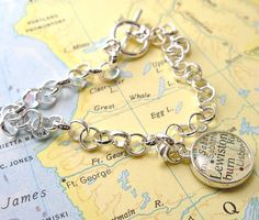 Delicate & dainty vintage map bracelet. Bracelet measures 7.5 inches & vintage map charm measure half an inch. Each map piece is an original snippet of vintage map cut directly from one of my old atlases. MEMBER - dlkdesigns