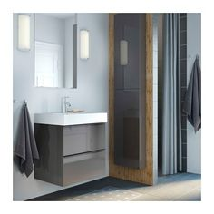 Une salle de bain qui permet de concilier bain et douche for Meuble mural godmorgon