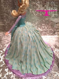 Frozen Elsa doll cake with glitter, hand painted snowflakes, pearl fabric effect