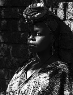 Beautiful african women hiding in the shadows.  Model: Nyakallo Phamuli