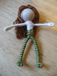 The Enchanted Tree: New Bendy dolls and Tutorial...They are very easy to make, and kids love them. i've had a lot of requests from folks asking just how they are made, so i thought i'd put together a tutorial. All you need is pipe cleaners, wooden beads for the head, embroidery floss and a bit of craft glue. For the hair you can use wool roving, yarn or embroidery floss they all work well. The clothing can be made from felt, fabric or silk flowers
