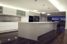 "White gloss poly kitchen with starphire glass splashback in Dulux ""Toffee Fingers"" - also lusting after those floorboards!"