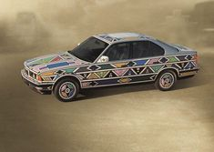 1991 BMW The Art Car was the first to have been signed by a woman. This is not the only fact that makes this BMW so special. The South African artist Esther Mahlangu coated the bodyw… Bmw 525i, Most Famous Artists, Robert Rauschenberg, South African Artists, Virtual Museum, Tumblr, Map Art, Art Cars, Traditional Art