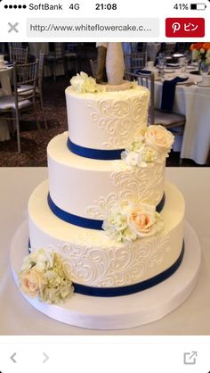 Lovely navy ribbon and detailed icing.