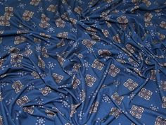 Decorative Print Stretch Viscose Jersey Knit Dress Fabric  Teal | Fabric | Dress Fabrics | Minerva Crafts