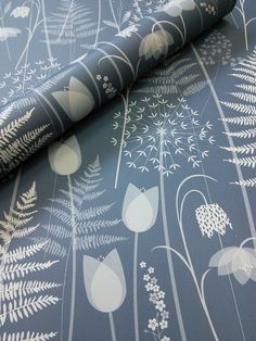 Charlotte's Garden in 'Inkwell', a deep inky blue by Hannah Nunn - a wallpaper inspired by the flowers in bloom in the Brontë Parsonage garden around the time of Charlotte Brontë's birthday. It features ferns, alliums, forget-me-nots, hellebores, fritillaries and tulips. A beautiful surface pattern design of spring flowers. You can order rolls and samples from my website https://www.hannahnunn.co.uk/collections/wallpaper and we ship worldwide