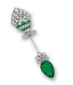 EMERALD AND DIAMOND JABOT PIN, CIRCA 1920, TIFFANY & CO. – Sotheby's Of Art-Deco design, the cypress-shaped motif encrusted with circular-, old mine-cut and baguette diamonds, enhanced by calibré-cut emeralds, to a similarly-set terminal applied with a pear-shaped emerald weighing 11.20 carats, the diamonds together weighing approximately 3.00 carats, mounted in platinum, signed.