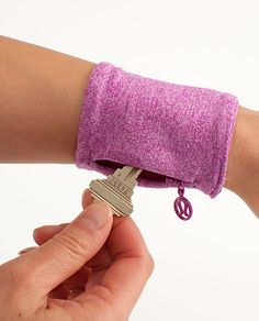 Sweat cuff > this is a photo of a product to purchase but... what a great idea for the male & female joggers / runners I know! >Alter colours to suit the recipient. >Should be easy enough to diy ... lining, rib knit & a less obvious pull tab for the invisible zipper (re safety reasons )