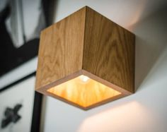 SC Sconce Wooden wall lamp with simple functional design. Soft yellow LED lightning. This lamp has two options: switch is located aside, or with wire. Made of OAK pieces with accent on natural wood texture. Polished and smoothed by hands using durable safe materials for best resistance, and natural wax to make a perfect shiny surface. Light oak spreads fine warmer lightning! Please note that original wooden texture is always unique. Color options: LIGHT OAK BOG OAK (dark brown) Block…