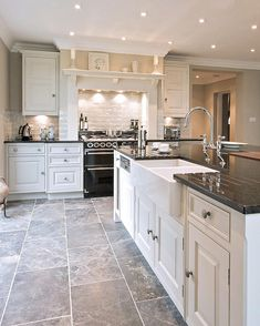 With this bespoke kitchen Cheshire Furniture Company supplied a dark marble floor - the characterful veining in the natural stone adds visual depth.