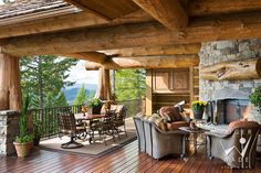 log cabin stock photo, rear covered deck with fireplace looking out to mountain view, whitefish, mt