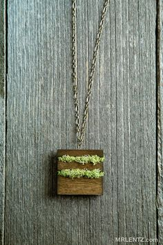 Moss and natural wood pendant $64