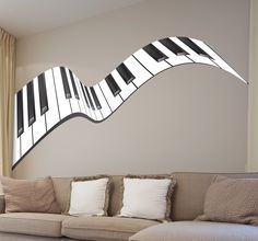 A beautiful sticker of a piano keyboard that appears to be floating across your wall.  Perfect for music lovers who want to decorate their homes in a personal way. Ideal also for decorating music classrooms or studios. #Piano #Music #Decoration