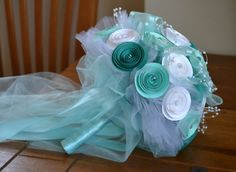 Here is a listing for a handmade and one of a kind paper wedding bouquet. This bouquet features 30 handmade turquoise/mint green/white flowers.Each