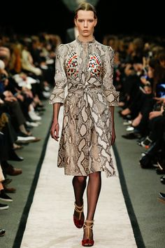 Givenchy Fall 2014-  I have a similar, but more structured Karen Millen w/o the pop of color at the chest.