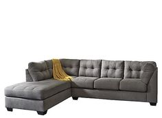 The comfortable, contemporary design of this Desmond 2-piece sectional sofa with full sleeper features plush boxed seating and back cushions, giving you the comfort you desire while helping enhance your home's decor with exciting jumbo stitch detailing and tufted accents that embrace the modern style.