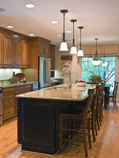 100 Kitchen Island Ideas. Some of these are too weird for me, but there are a few that I like.