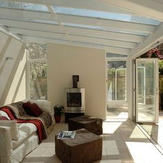 Conservatory with bi-folding doors | Modern conservatory | Conservatory | PHOTO GALLERY | 25 Beautiful Homes | Housetohome.co.uk