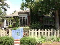 Adorable Laguna Beach cottage with periwinkle front gate