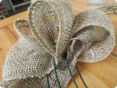 How to Make a Burlap Wreath, this girl shows you the steps