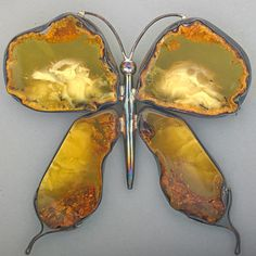 LARGE SILVER AMBER BUTTERFLY BROOCH; Composed of four polished Baltic amber sections.