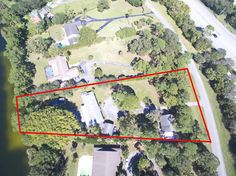 New On The Market: Great investment opportunity with 1.44 acres of lakefront! LARGE DETACHED GARAGE WITH UPSTAIRS APARTMENT.