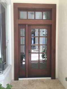 "3/0 x 6/8,  1-3/4"" #SapelleMahogany, 8-Lite true divided with beveled glass over 1-Panel door with raised moulding."