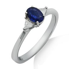 This simple 18k white gold ring features a lovely 0.63ct sapphire with two trilliant cut diamonds on each side of the stone. The color of the diamonds are G/H and the clarity is SI2/SI3.Different ring sizes may be available. Please inquire for details. $500.00