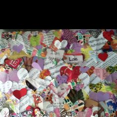A collage I made with heart shaped scraps from magazines, catalogues, sheet music, cards, doodles, etc. on a canvas.  So easy and so cute!
